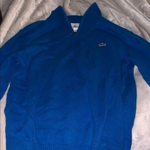 A Lacoste pullover.